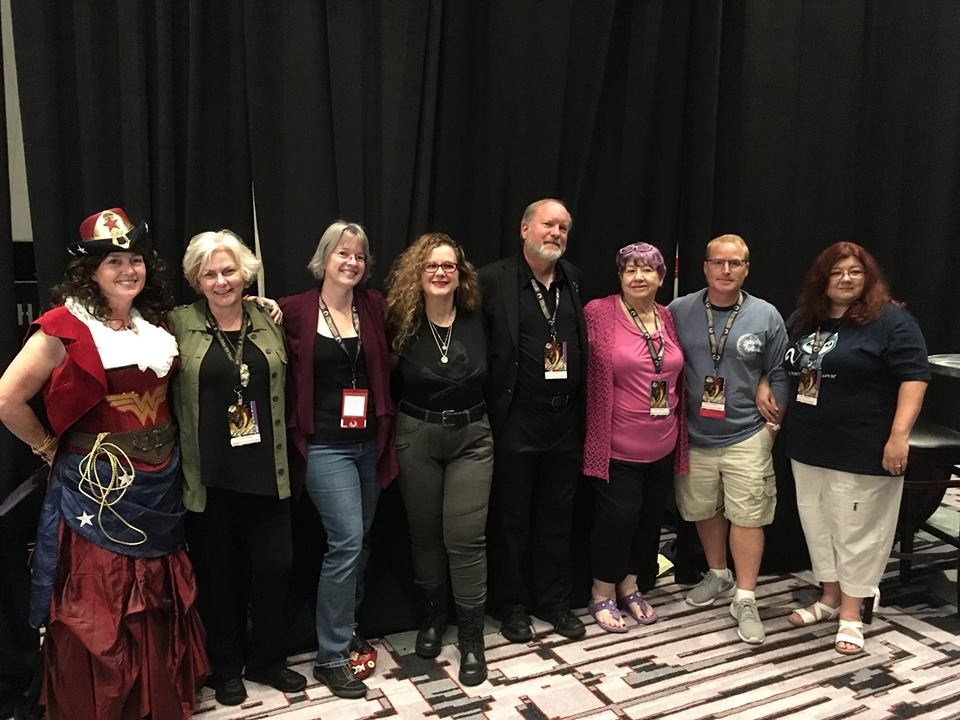 The Next Day Was My Personal Panel And As Was My Wont I Sat On The Table So I Could See You Better With Me Is Carol Who Runs The Urban Fantasy